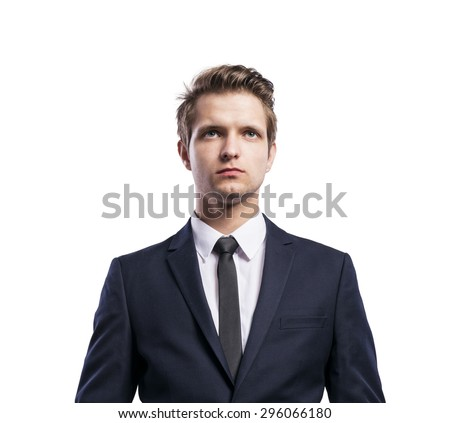 Young handsome businessman. Studio shot on white background. - stock photo