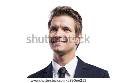 Young handsome businessman. Studio shot on white background.