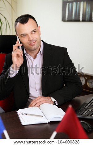 young handsome businessman talking on a cell phone