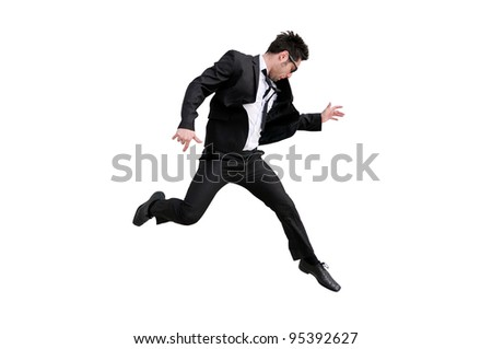 Young handsome businessman with eyeglasses jumping, isolated on white