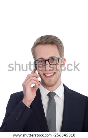 Young Handsome Businessman with Eyeglasses Talking to Someone Through his Mobile Phone. Isolated on White Background