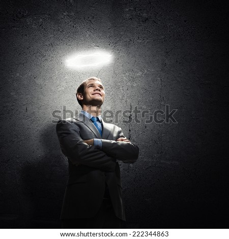 Young handsome businessman with halo above head
