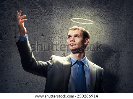 Young handsome businessman with nimbus above head