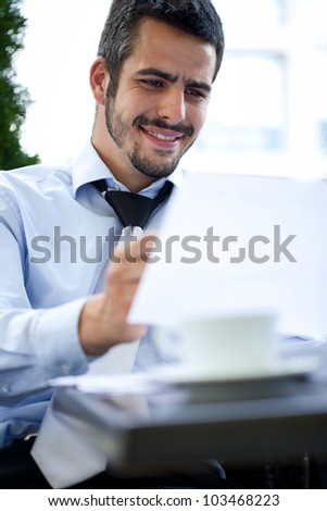 young handsome businessman working, outdoor