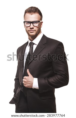 Young handsome businessmanman in black suit and glasses isolated on white background