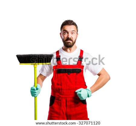Young handsome cleaner in red overalls. Studio shot on white background - stock photo