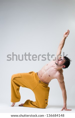 Young handsome dancer exercising, studio shot - stock photo