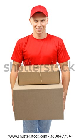 Young handsome delivery man with carton boxes, isolated on white - stock photo