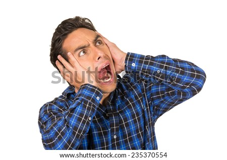 young handsome desperate angry man wearing a blue plaid shirt posing covering ears isolated on white - stock photo