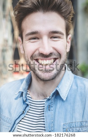 young handsome fashion model man outdoors - stock photo