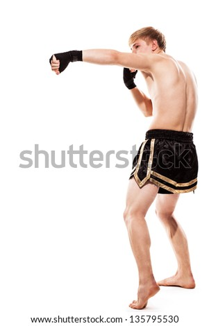 Young handsome fighter in shorts isolated over white baqckground