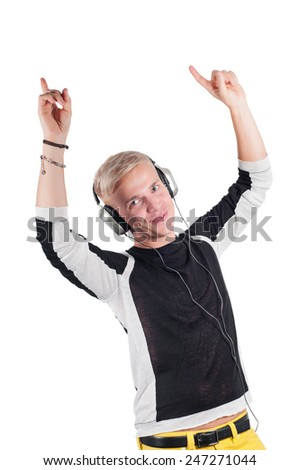 Young handsome guy dancing with headphones  - stock photo