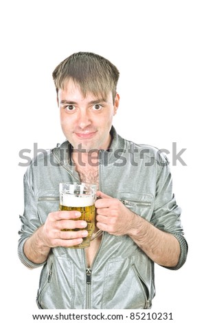 young handsome guy standing and drinking beer from a large mug, isolated over white