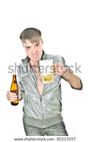 young handsome guy standing with a bottle and mug, isolated over white
