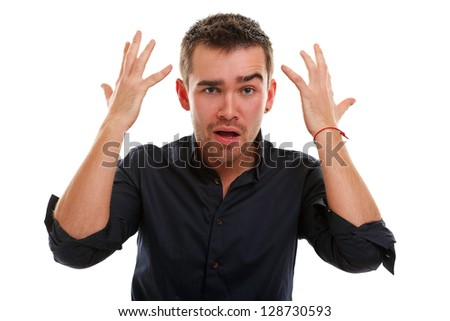 Young handsome guy surprised isolated over white background