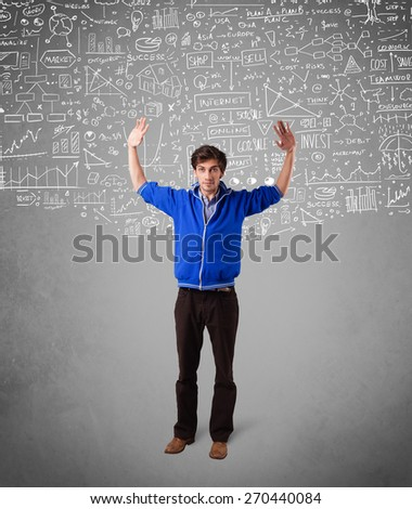 Young handsome guy with hand drawn white calculations and icons - stock photo