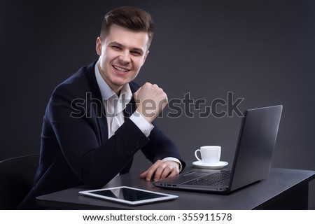 Young Handsome Happy Director Sitting At The Table. Business Theme