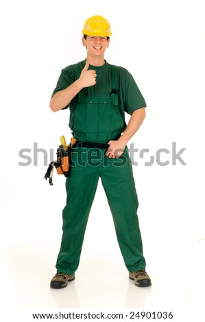 Young handsome happy male construction worker with green overall and shirt. Studio shot, white background. - stock photo