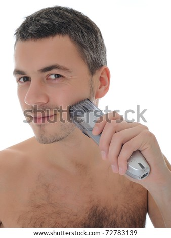 Young handsome male shaving face beard . isolated on white background