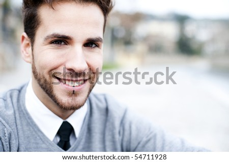 Young handsome man close portrait.
