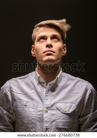 Young handsome man dressed casual posing in the studio. Fashion portrait. - stock photo