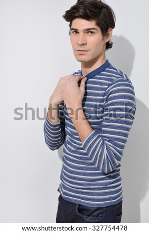 young handsome man-gray background - stock photo