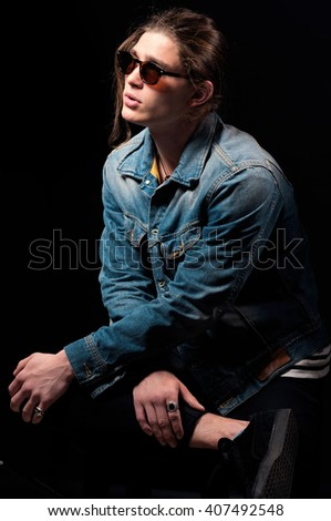 Young handsome man. Handsome men. Jeanswear. Casual style. Toned image.