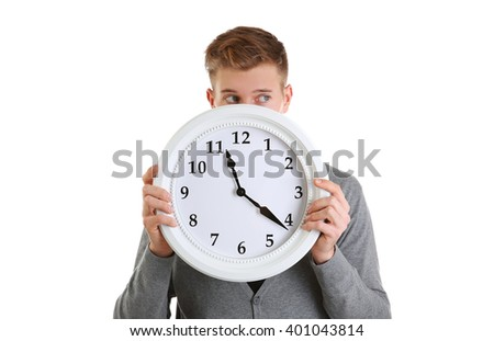 Young handsome man holding clock, isolated on white