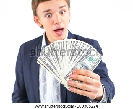 Young handsome man holding dollars. Focus on the money. Isolated on white background