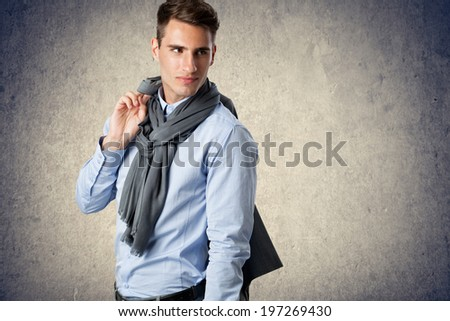 Young handsome man holding jacket over shoulder - stock photo