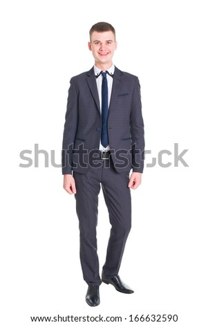young handsome man in a classic suit isolated on white background in all growth