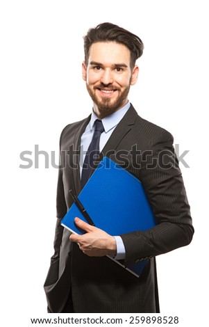 Young handsome man in black suit and folder smiling isolated on white background - stock photo