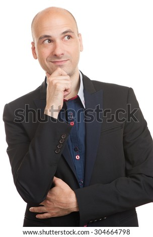Young handsome man in black suit looking at copy space thinking - stock photo