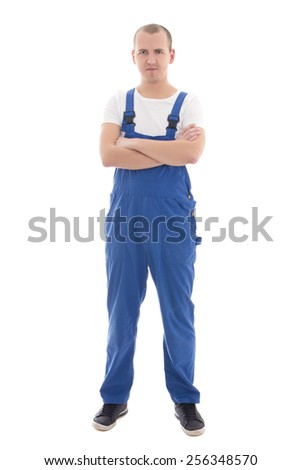 young handsome man in blue workwear isolated on white background - stock photo