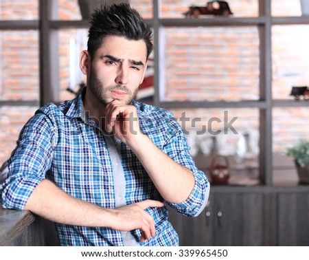 Young handsome man in cafe - stock photo