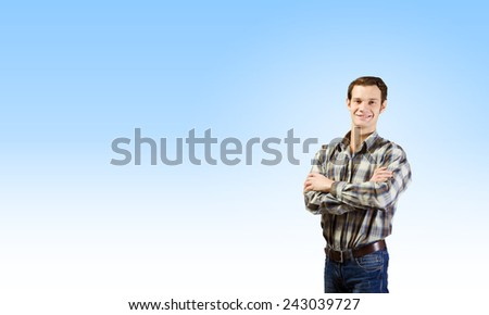 Young handsome man in casual thinking over something