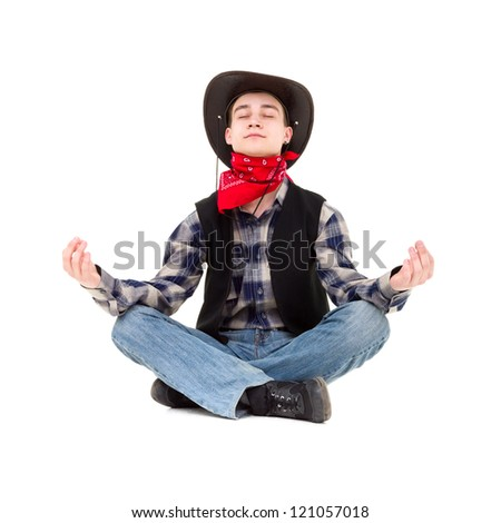 Young handsome man in cowboy's hat meditates sitting on a white background - stock photo