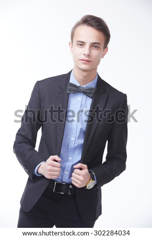young handsome man in elegant suit with butterfly