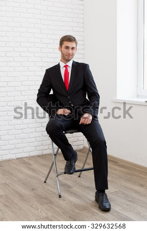 Young handsome man in formal suit