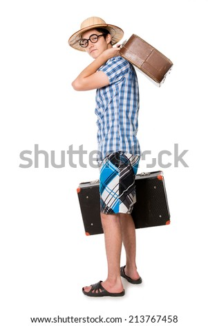 Young, handsome man in glasses with two bags ready to travel. The stereotype of a foolish novice traveler. Portrait of a traveler in a full-length isolated on white background - stock photo