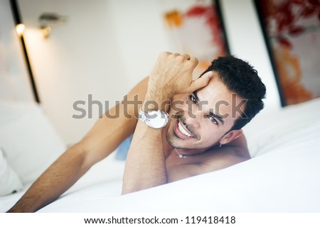 Young handsome man in his bedroom - stock photo