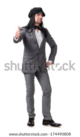 Young handsome man in modern cap showing ok sign on a white background