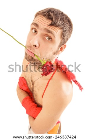 young handsome man in red wings hold in mouth red rose gift for Valentine day