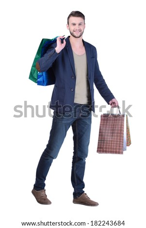 Young handsome man in suit with shopping bags. isolated on white background