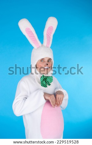 young handsome man in the costume of the cute sweet little hare - stock photo
