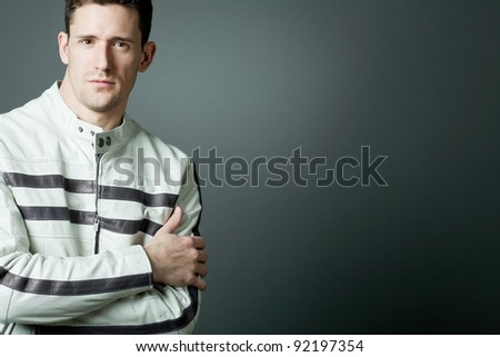 Young handsome man in white leather jacket. - stock photo