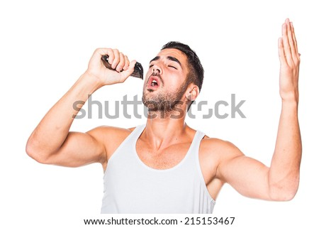 young handsome man in white shirt singing with a trimmer