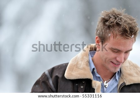 young handsome man outdoor in winter - stock photo