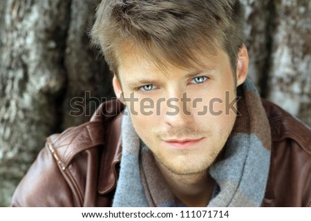 Young handsome man outdoors - stock photo