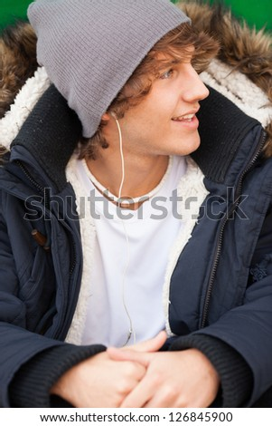 young handsome man portrait with headphones - stock photo